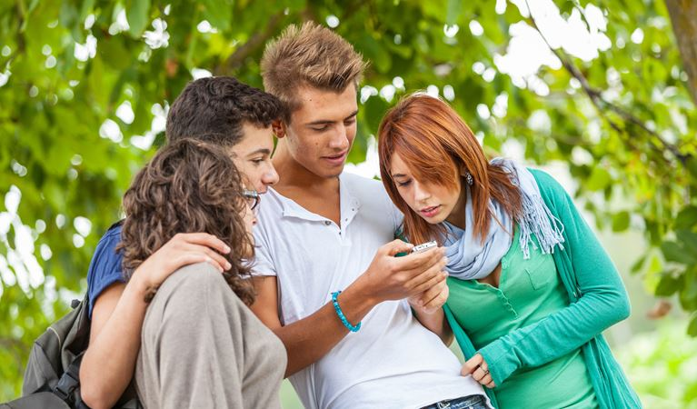 shutterstock 112984414%5b1%5d group of teenage friends with mobile phone
